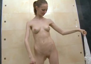 Skinny Gloria with beautiful buxom boobs dabbles in the bath with their way tiny, elegant pussy! She looks so innocent, but this babe can invite your dick in their way asshole with pleasure!
