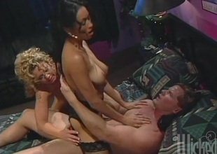 A blonde increased by a brunette suck increased by byway a cock by turns