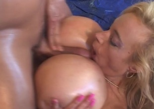Fair-haired with absurdly big boobs in heaviness titjob action