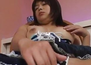 Rampant asian toys her hot pussy