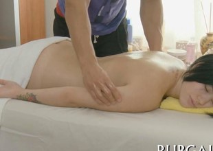 amateur brunette at her massage table gets fucked