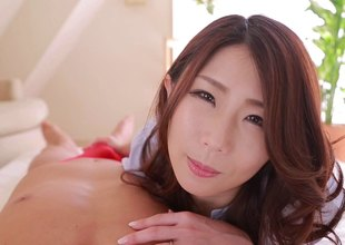 Cock sucking Japanese chick gives be passed insusceptible to best handjob everlastingly