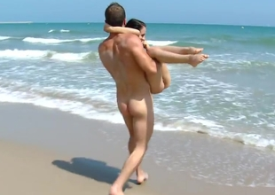 Young tourist get pounded on a difficulty seashore